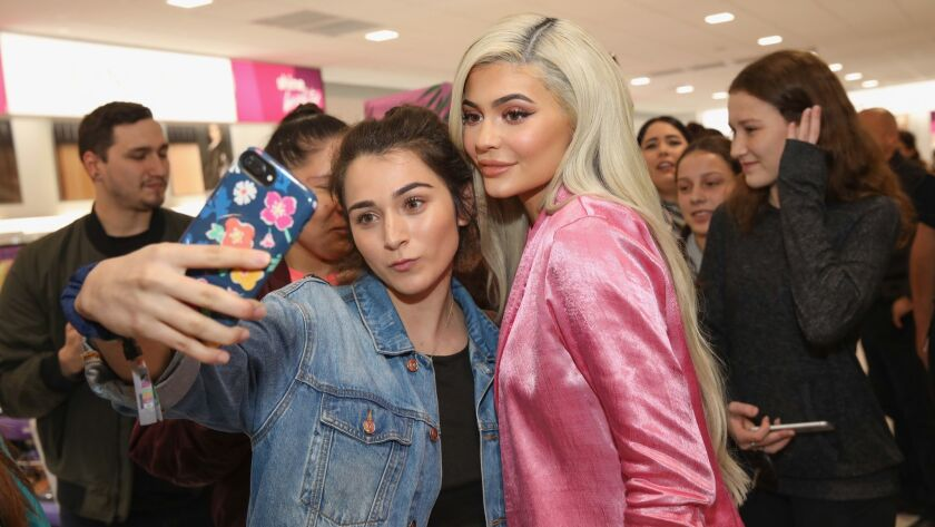 Kylie Jenner, right, visits an Ulta Beauty store in Houston on Nov. 18 to promote her cosmetics line.