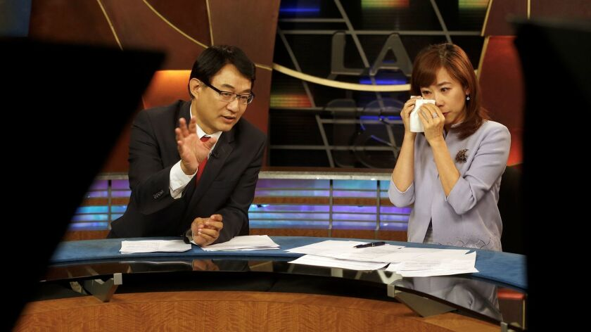 Channel 18 news anchors Harry Chang and Christine Chiang, right, lead their final KSCI-TV broadcast