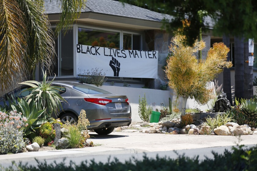 Black Lives Matter and Justice for George Floyd signs have appeared on streets signs in Del Cerro
