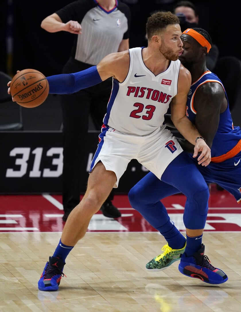 Detroit Pistons forward Blake Griffin (23) is defended by New York Knicks forward Julius Randle during the first half of a preseason NBA basketball game Friday, Dec. 11, 2020, in Detroit. (AP Photo/Carlos Osorio)