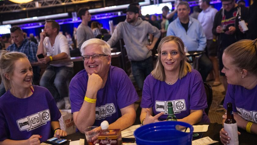 The Lankfords of Kansas City, Mo., (L-R) Paige Lankford, lan Lankford, Stephanie Lankford-Scovill and Megan Lankford, 25, watch NCAA tournament basketball games at The Cosmopolitan's Hoops & Hops event on March 22, 2019, in Las Vegas.