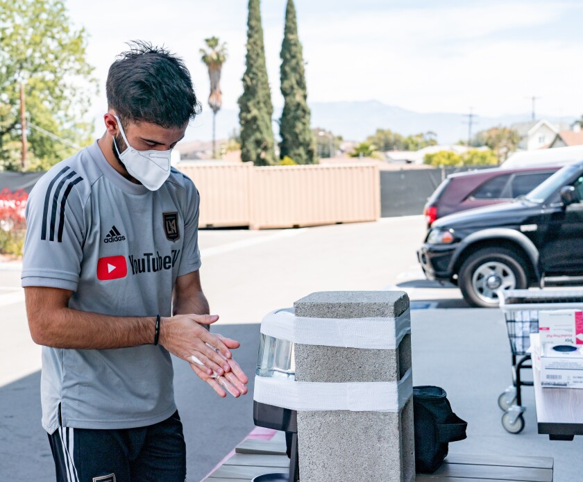 LAFC forward Diego Rossi uses some hand sanitizer during a team training session on Thursday.