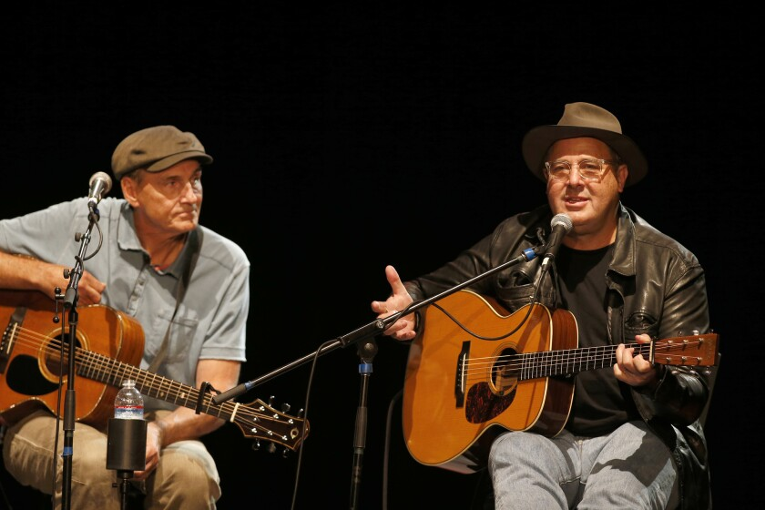 James Taylor, left, and Vince Gill perform at the All for the Hall Los Angeles at the Novo Theatre on Sept. 27, 2016.