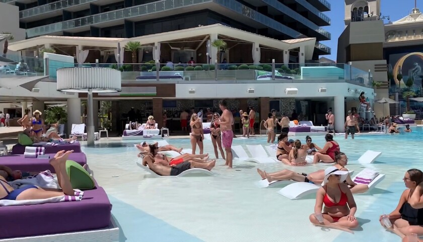 Masks and social distancing are so last month at the swimming pool at the Cosmopolitan in Las Vegas.