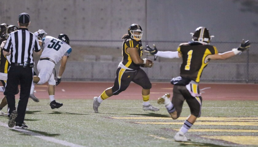 El Camino lineman Isaac Tinoisamoa returns a fumble for a touchdown early in the Wildcats' win over Valley Center.