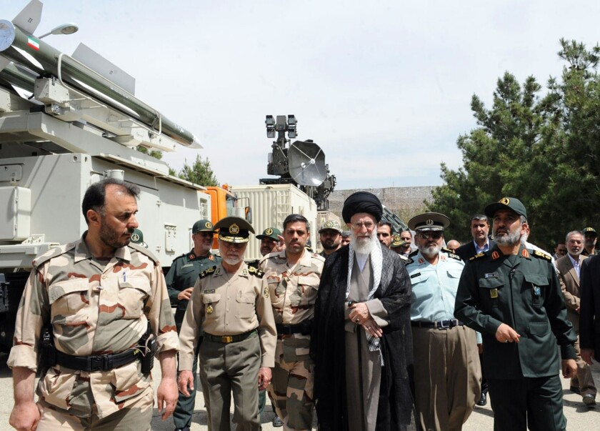 Ayatollah Ali Khamenei, center, visits an aerospace exhibition in Tehran with military commanders.