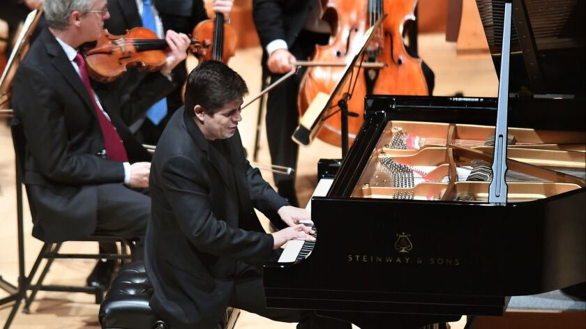 LOS ANGELES, CA-OCTOBER 1, 2012: Pianist Javier Perianes performs with conductor Gustavo Dudamel and