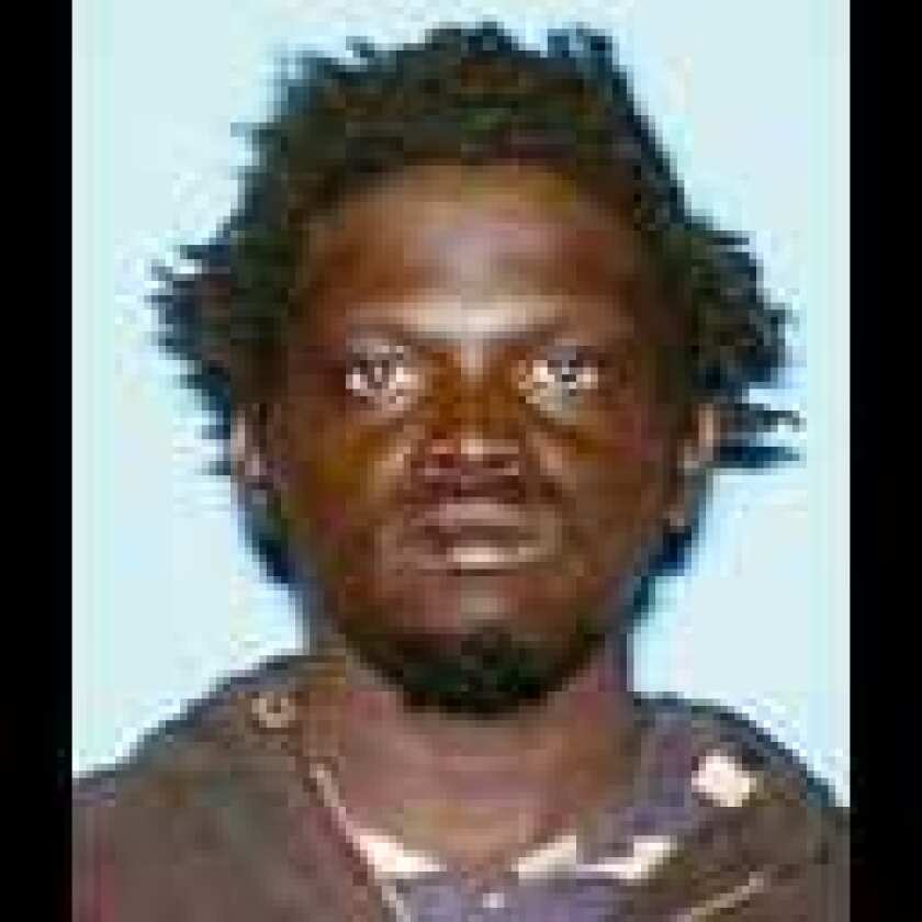 Babatunsin Olukunle was seen feeding a fire in Angeles National Forest on Aug. 20, 2009