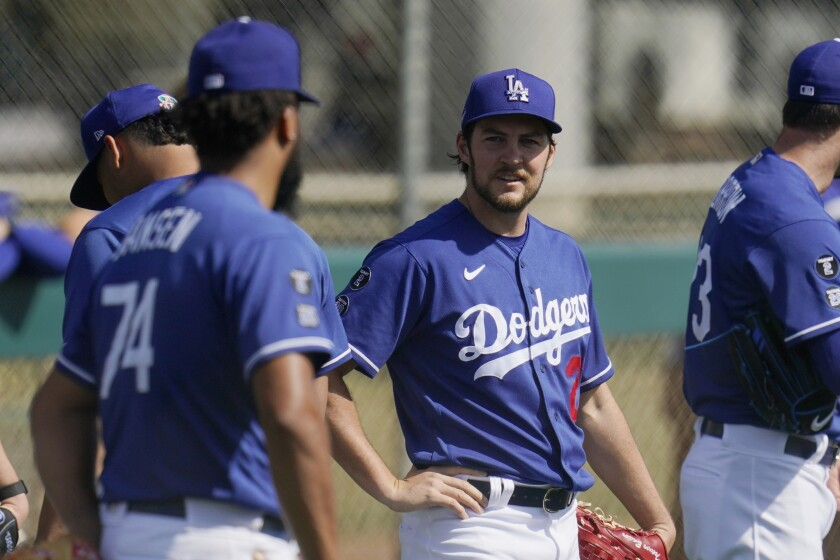 Los Angeles Dodgers starting pitcher Trevor Bauer, right, talks with Dodgers relief pitcher Kenley Jansen.