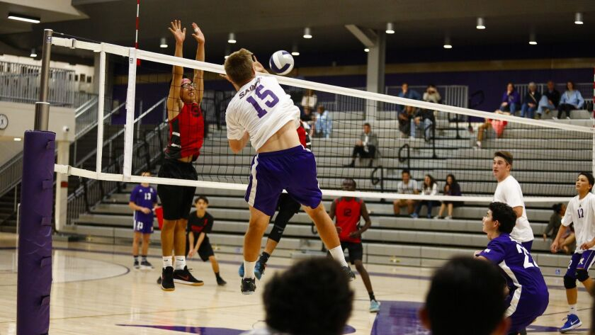 St. Augustine's Robert McRoskey (15), who had 11 kills to go with four blocks, blasts the ball against Hoover. The Saints improved to 8-0 overall this season.