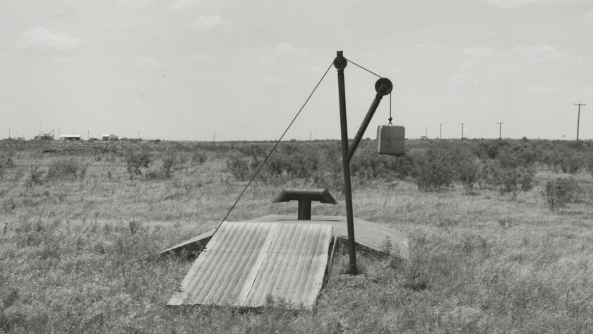 """Frank Gohlke, """"Storm cellar behind (vanished) foreman's house -- Ross Family ranch near Jolly, Texas [detail],"""" 1984, silver gelatin print."""