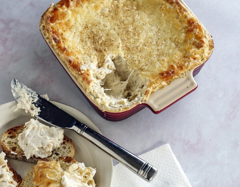 """Chesapeake Bay Hot Crab Dip is """"slimmed down"""" with lower-calorie ingredients and slathered on thinly sliced French bread."""