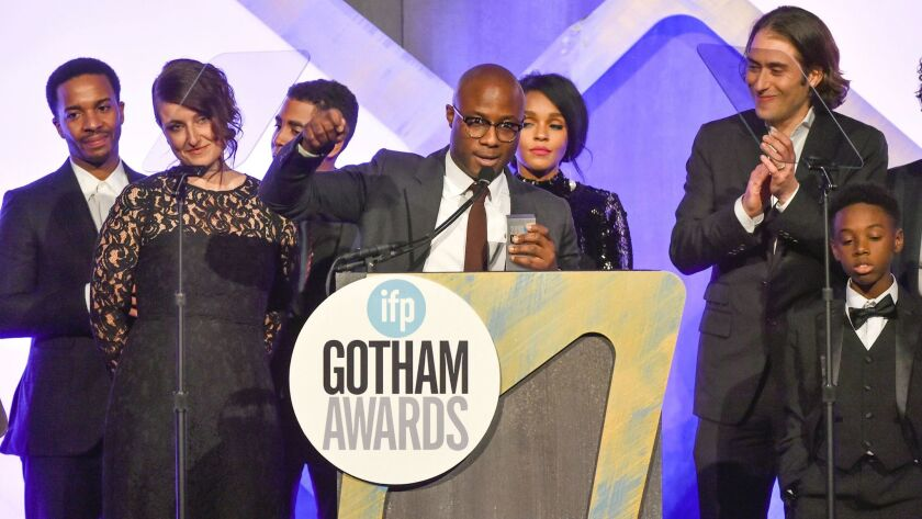 """Writer-director Barry Jenkins accepts the best feature film award with the """"Moonlight"""" cast Nov. 28 at the 26th Annual Gotham Independent Film Awards in New York."""