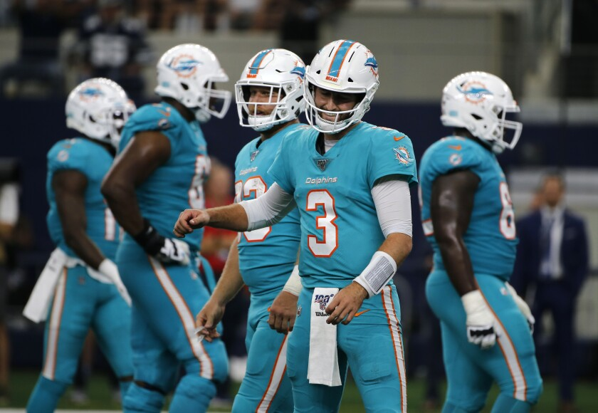 Miami Dolphins' Josh Rosen gestures after the Dolphins were charged with a false start penalty in the second half against the Dallas Cowboys in Arlington, Texas on Sept. 22.