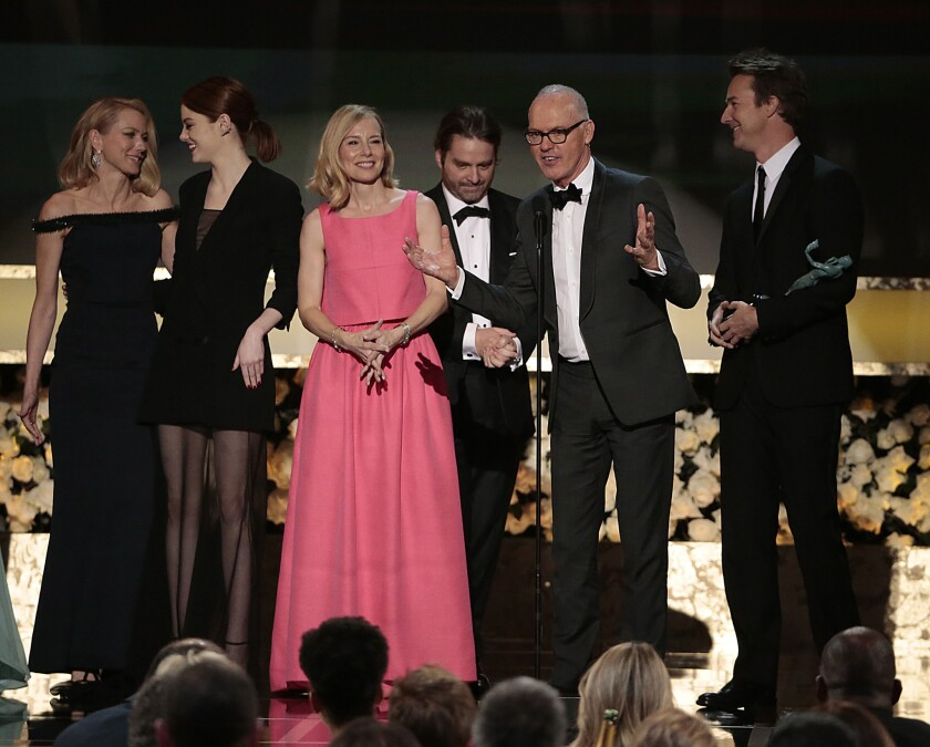 """Naomi Watts, from left, Emma Stone, Amy Ryan, Zach Galifianakis, Michael Keaton and Edward Norton accept the award for cast in a motion picture for Alejandro G. Inarritu's dark comedy """"Birdman."""" Lead actor Michael Keaton called acting """"the ultimate team sport -- so collaborative."""""""