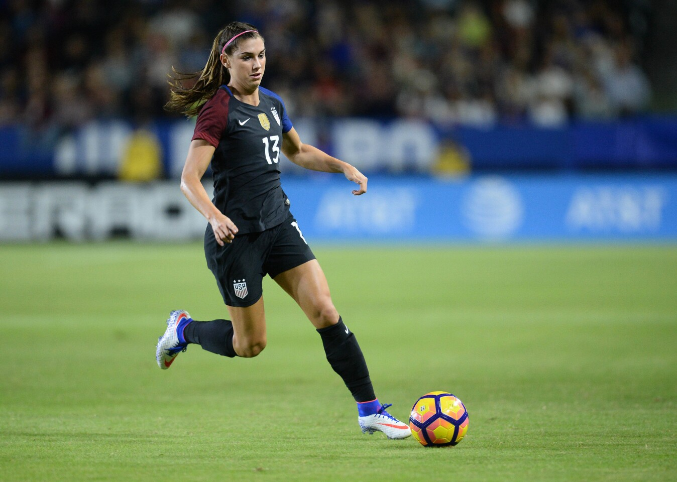 November 13, 2016; Carson, CA, USA; USA forward Alex Morgan (13) moves the ball against Romania during the second half at StubHub Center. Mandatory Credit: Gary A. Vasquez-USA TODAY Sports ** Usable by SD ONLY **