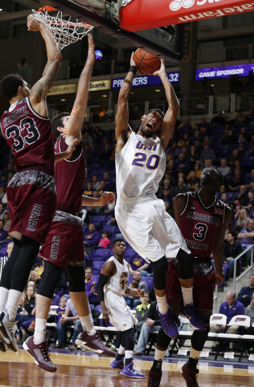 Northern Iowa's Jeremy Morgan, right, crashes into the boards for the shot during the first half of an NCAA college basketball game against Missouri State, Wednesday, Feb. 10, 2016, in Cedar Falls, Iowa. (Matthew Putney/The Courier via AP) MANDATORY CREDIT