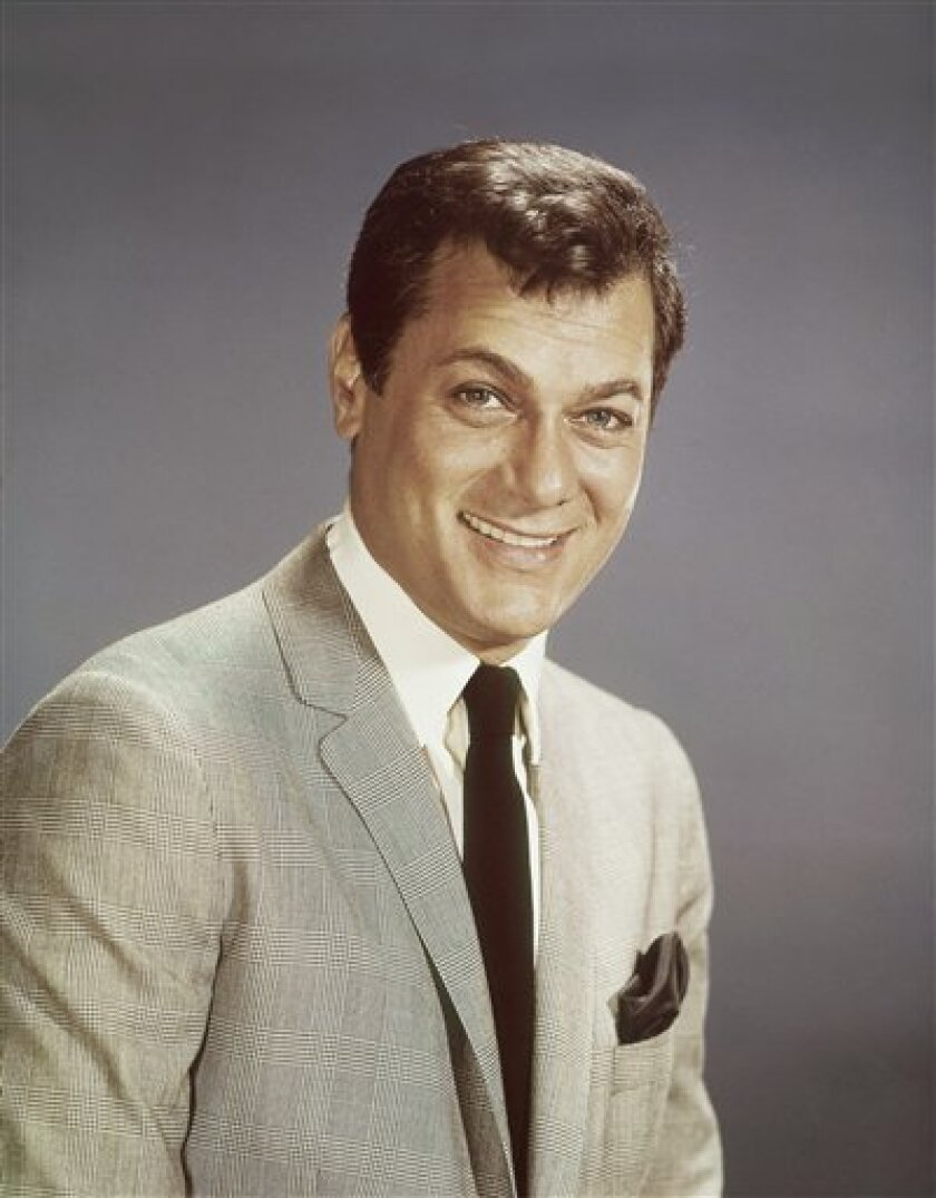FILE - Actor Tony Curtis is shown in this 1965 file photo. Curtis, whose real name was Bernard Schwartz, was perhaps most known for his comedic turn in Billy Wilder's 'Some Like It Hot' with co-stars Marilyn Monroe and Jack Lemmon has died at 85 according to the Clark County, Nev. coroner. (AP Photo, File)
