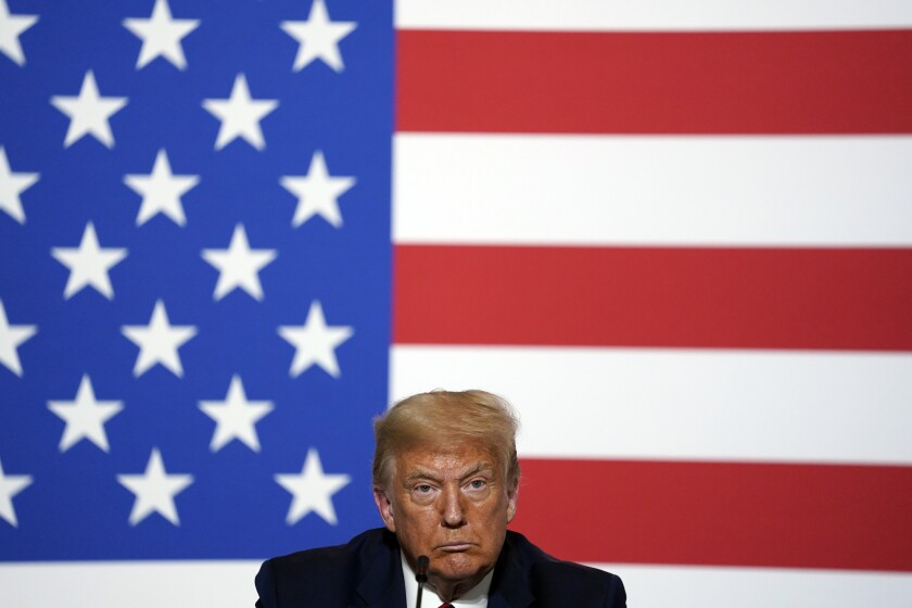 President Trump in front of a U.S. flag.
