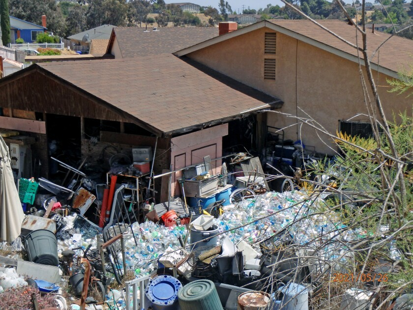 Cluttered backyard of home
