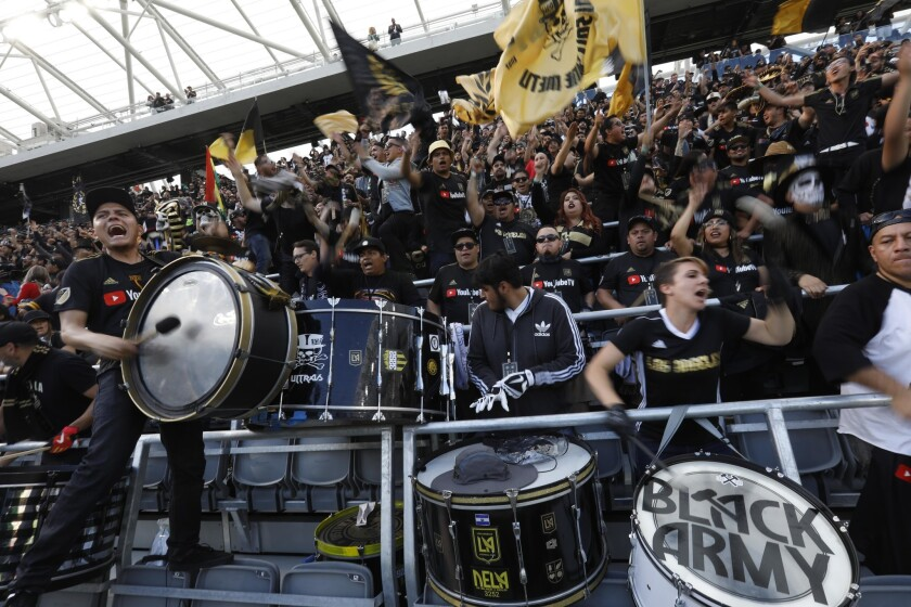 LAFC fans chant before a match against the Seattle Sounders in April 2018.