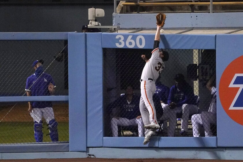 San Francisco Giants left fielder Darin Ruf can't reach a ball hit for a two-run home run by Los Angeles Dodgers' Will Smith during the fourth inning of a baseball game Friday, Aug. 7, 2020, in Los Angeles. (AP Photo/Mark J. Terrill)