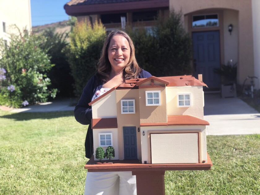 Krystn Monroe with her family's Little Free Library.