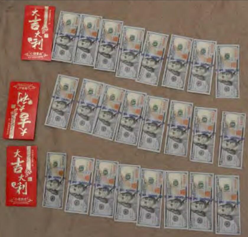 Straps of 100-dollar bills