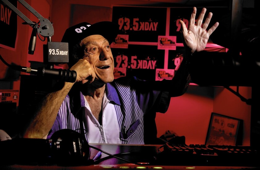 Art Laboe gets ready for his new call-in dedication radio show in the KDAY studios in Palm Springs on June 1, 2015.