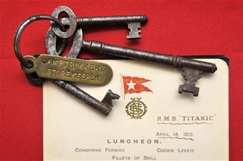 This Wednesday March 28, 2012 shows a menu given to first class passengers on the day of the sinking of the Titanic and a set of keys used by Titanic crewman Samuel Hemming to unlock the door where the lifeboat lanterns were held after he was ordered by the ship's Captain to ensure all 15 lifeboats