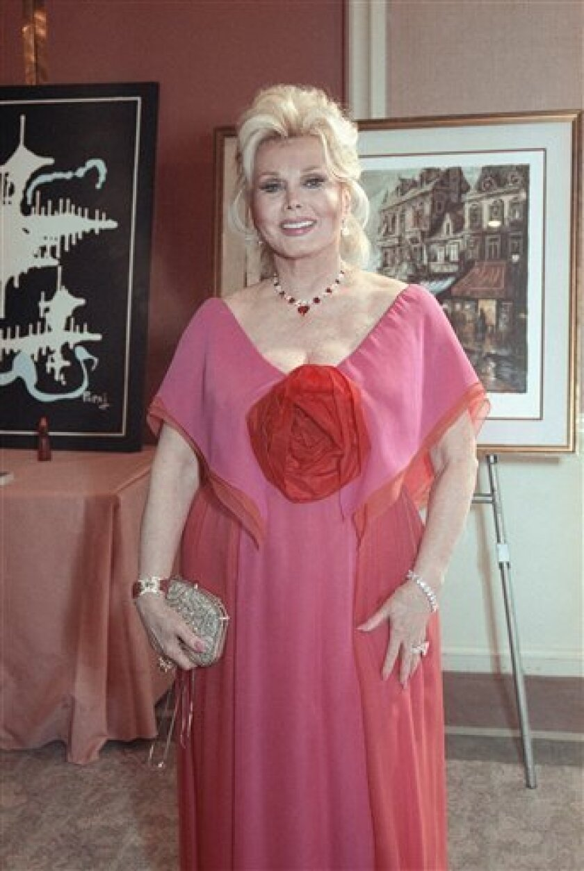 FILE -- In a June 8, 1990 file photo Zsa Zsa Gabor smiles at a charity auction in Beverly Hills, Calif. A representative for Gabor said Sunday Jan. 2, 2011 that she is back in a Los Angeles hospital to have part of her leg amputated. (AP Photo/Julie Markes/file)