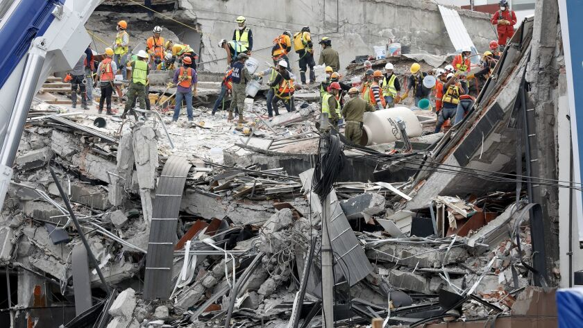 The search continues Sunday for victims buried under the rubble of an office building along Avenida Alvaro Obregon in Mexico City's Roma district.