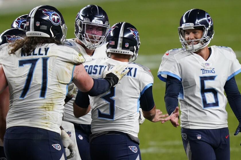 Tennessee Titans kicker Stephen Gostkowski (3) celebrates his game winning field goal with teammates during the second half of an NFL football game against the Denver Broncos, Monday, Sept. 14, 2020, in Denver. The Titans won 16-14. (AP Photo/David Zalubowski)