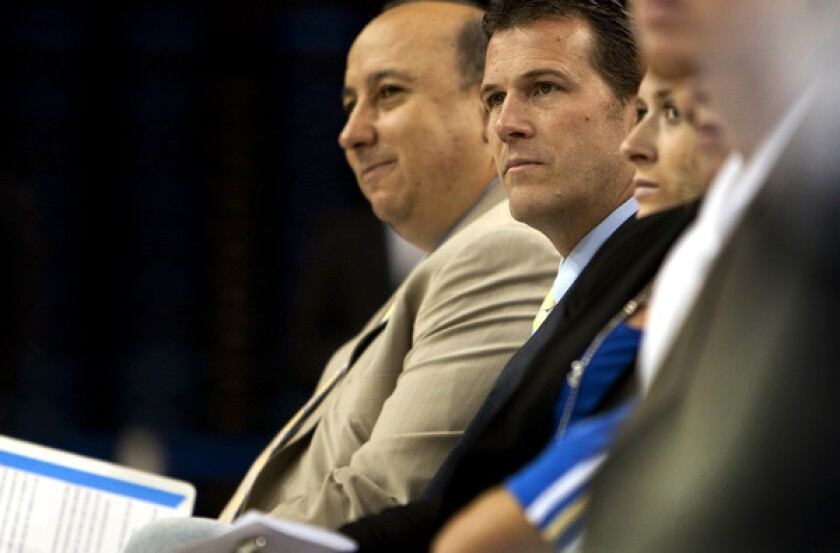 Steve Alford's salary is 14.8 times higher than John Wooden's pay