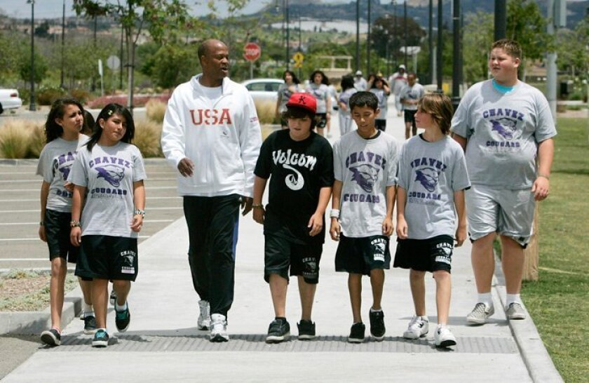 Olympian Willie Banks visits the students at Chavez Middle School in Oceanside.