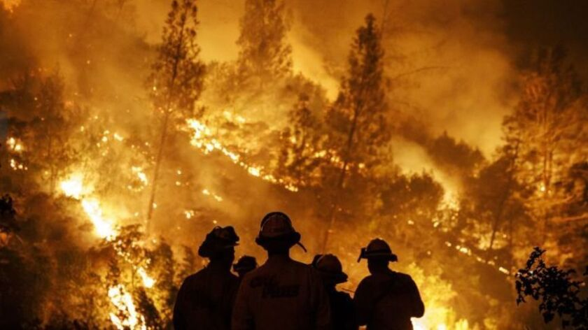 Firefighters battling California's largest fire hit by