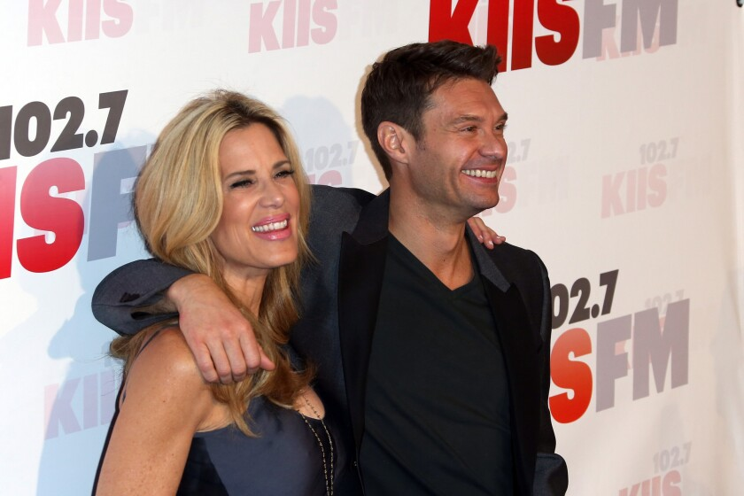 """The probe into possible ratings manipulation was launched after KSCA morning show """"El Bueno, La Mala y El Feo"""" leapfrogged to the No. 1 slot over big names such as KIIS-FM (102.7) morning host Ryan Seacrest, left, with fellow radio personality Ellen K."""