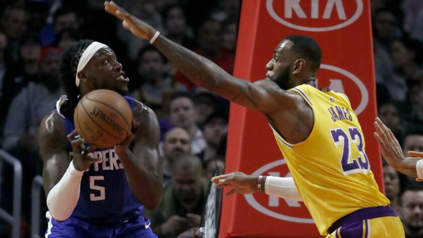 LOS ANGELES, CALIF. - JAN. 31, 2019. Lakers forward LeBron James defends against Clippers center Mo