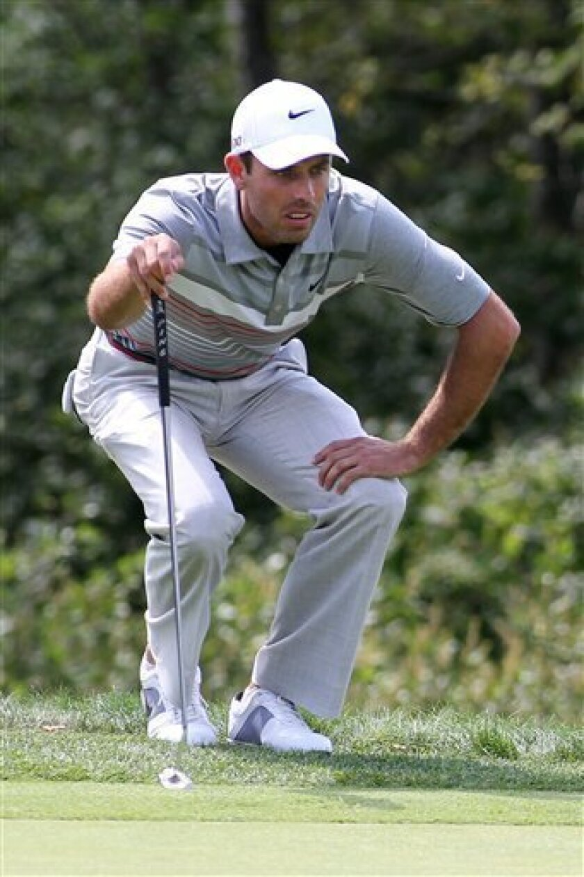 Charl Schwartzel reads the green on the 18th hole during the first round of the Deutsche Bank Championship golf tournament at TPC Boston, Friday, Sept. 2, 2011, in Norton, Mass. (AP Photo/Stew Milne)