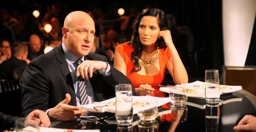 """Top Chef"" judge Tom Colicchio lays some wisdom on a contestant while Padma Lakshmi looks on."