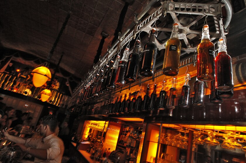 Bottles hang from a rotating delivery mechanism over the bar at Sassafras Saloon in Hollywood.