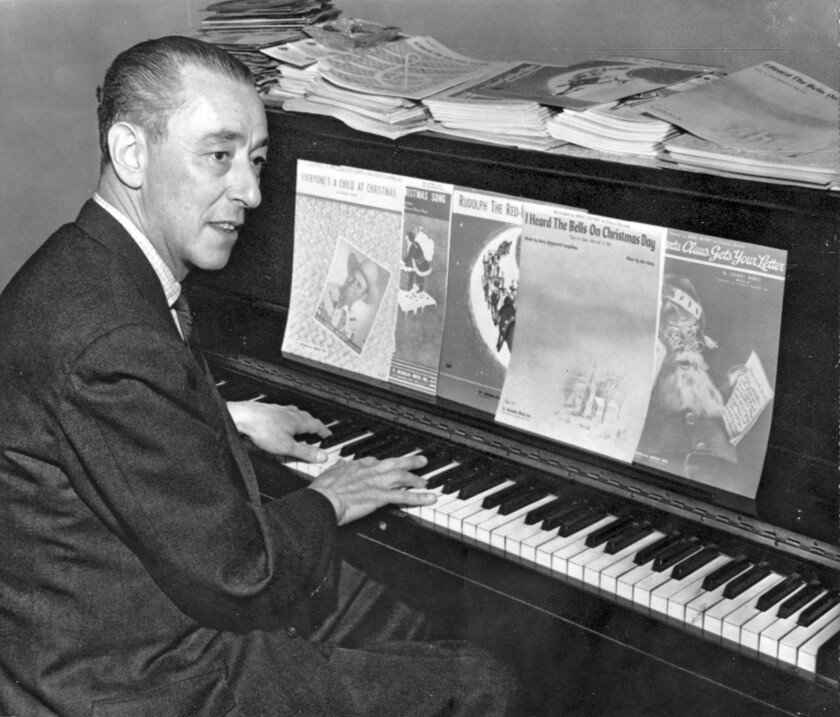 """Johnny Marks, writer of the hit song """"Rudolph, the Red-Nosed Reindeer"""" and other Christmas hits, in 1956."""