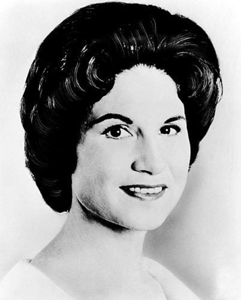 """Kitty Wells, the long-reigning """"Queen of Country Music,"""" laid a template for female singers in country music that started a shift in traditional male-female roles in rural society."""