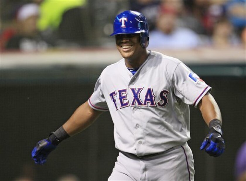 Texas Rangers' Adrian Beltre smiles after scoring on a single by Michael Young in the seventh inning of a baseball game against the Cleveland Indians, Friday, Aug. 31, 2012, in Cleveland. (AP Photo/Tony Dejak)