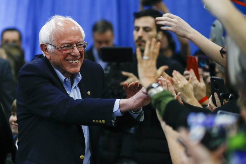 Democratic presidential candidate Sen. Bernie Sanders, I-Vt., greets supporters during a primary night election rally in Essex Junction, Vt., Tuesday, March 3, 2020. (AP Photo/Matt Rourke)