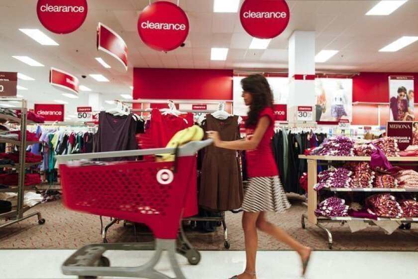A shopper pushes a trolley through a store in Chicago. Americans spent at the fastest pace in six months in August but much of that increase went to pay their higher gas bills, the Commerce Department announced Friday.