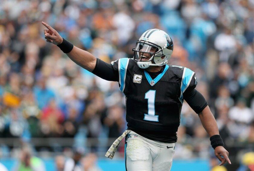 Carolina quarterback Cam Newton celebrates a touchdown pass against the Green Bay Packers on Nov. 8.