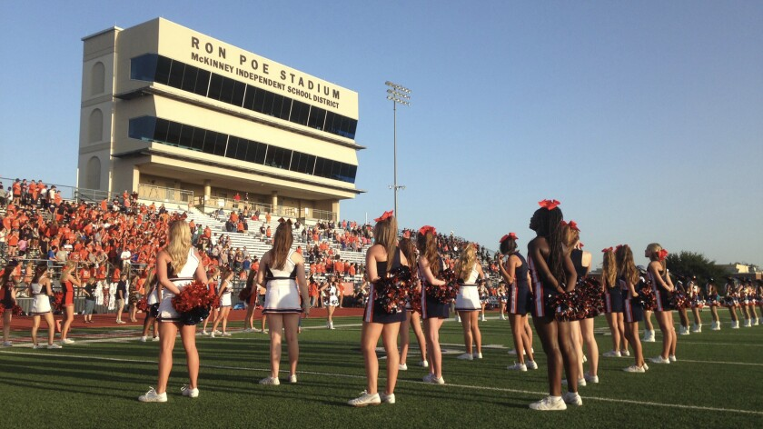 Cheerleaders on the field of McKinney North High School before their homecoming game Sept. 8. The school district plans to break ground soon on a new stadium expected to cost $70 million.