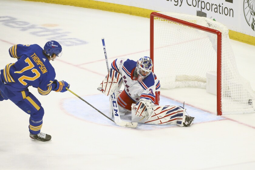 Buffalo Sabres forward Tage Thompson (72) puts the puck past New York Rangers goalie Igor Shesterkin (31) during the shootout of an NHL hockey game, Saturday, April 3, 2021, in Buffalo, N.Y. (AP Photo/Jeffrey T. Barnes)
