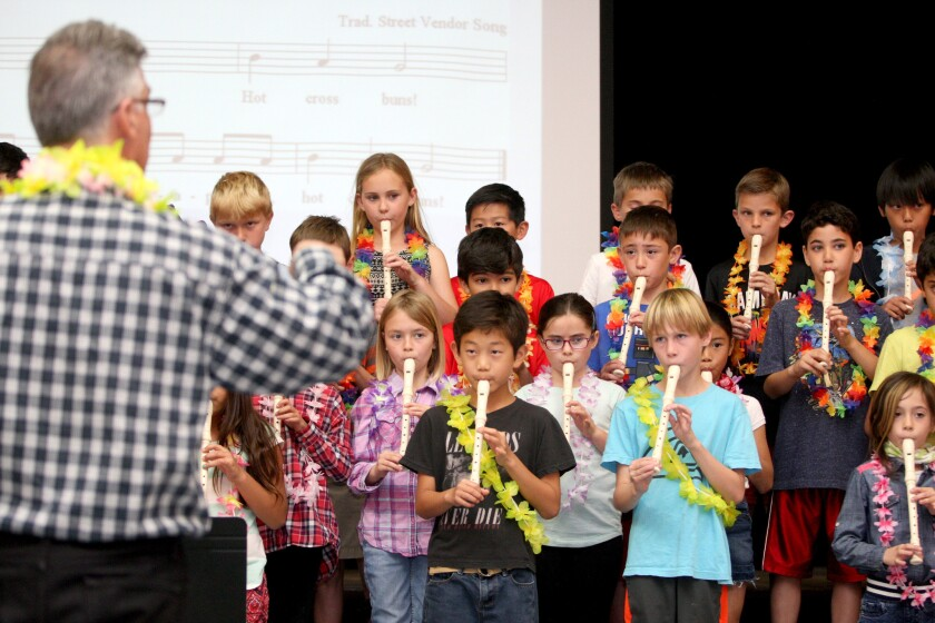 Lincoln Elementary School third-graders play recorders